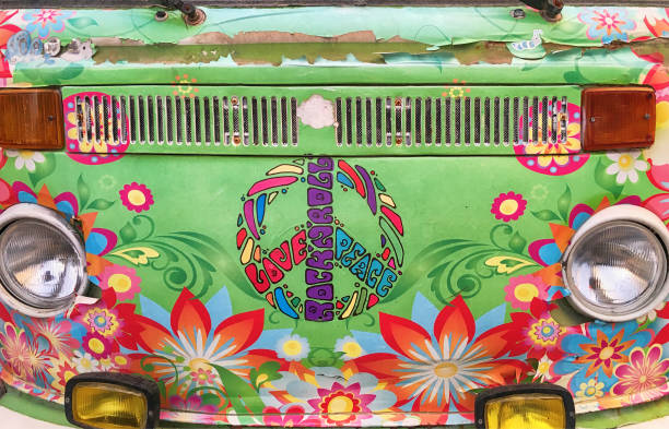 front view of a hippie mini van - symbols of peace stock photos and pictures