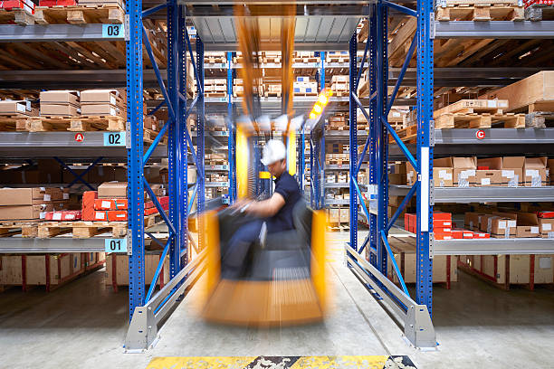 Front view of a man driving a forklift stock photo