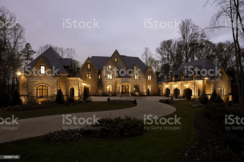 Front View of a Mansion at Dusk stock photo