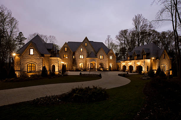 front view of a mansion at dusk - stately home stock photos and pictures