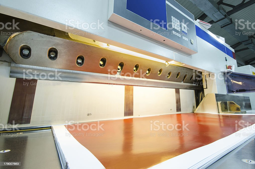 Front view of a modern paper guillotine with touch screen stock photo