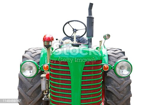 Front view of a vintage green tractor isolated on white