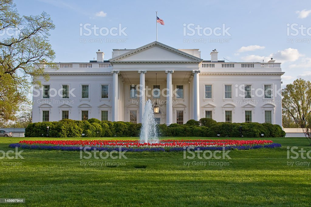 Front view of a White House featuring a fountain out front stock photo