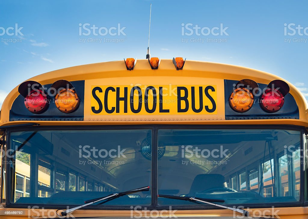 Front view of a yellow school bus stock photo