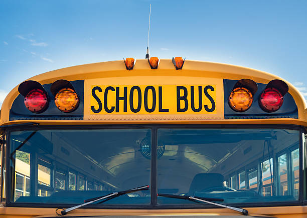 front view of a yellow school bus - school bus stock photos and pictures