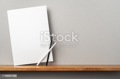 istock front view of A4 hard paper stand on bookshelf 1140031250