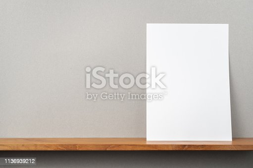 istock front view of A4 paper stand on bookshelf 1136939212