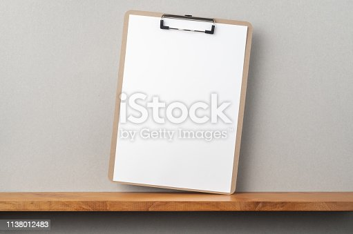 istock front view of A4 paper with clipboard on bookshelf 1138012483