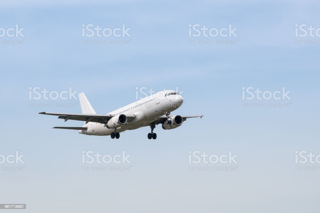 Front view of airplane approaching an airport for landing. stock photo