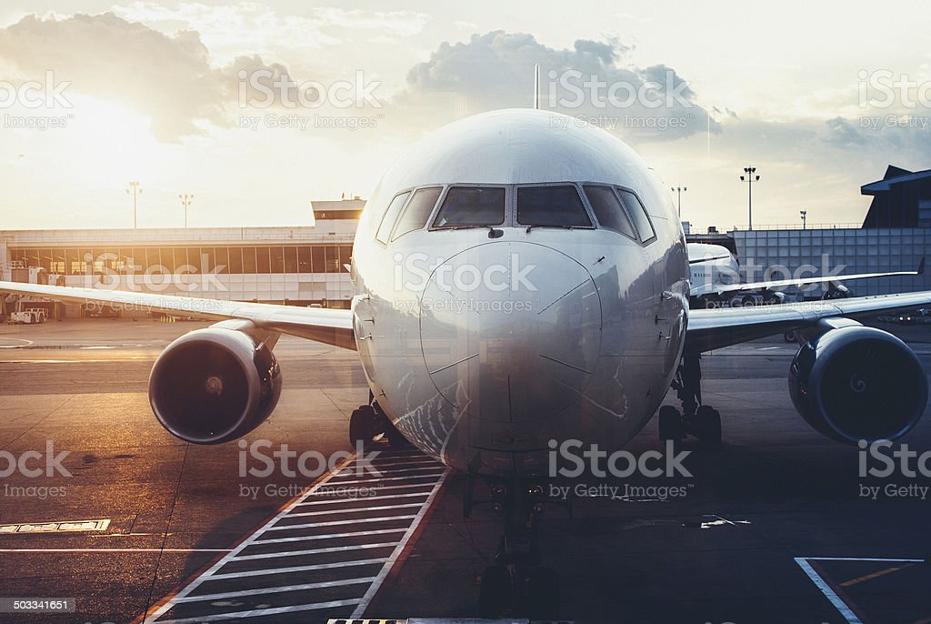 front view of airplane in the airport stock photo