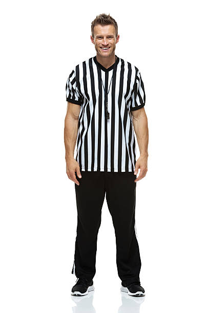 Front view of American football referee Front view of American football refereehttp://www.twodozendesign.info/i/1.png referee stock pictures, royalty-free photos & images