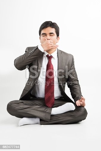 Front View Of An Indian Young Businessman Meditating Or Practicing Yoga Or Pranayama Or Breathing Exercise In Corporate Attire In The Office Or Isolated Over White Background - Fotografie stock e altre immagini di Abbigliamento da lavoro