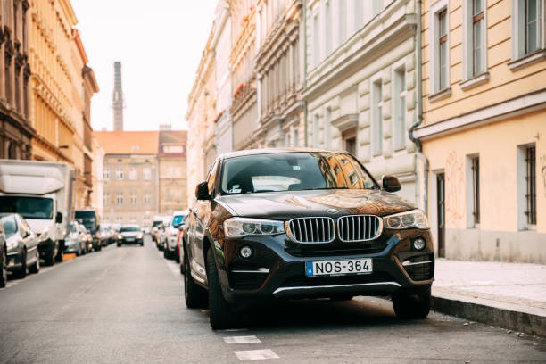 Front View Of Black BMW X6 F16 Car Parked In Street. Car Of Seco stock photo