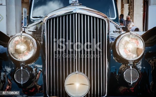 Front view of classic vintage car. Retro toned postcard, poster.
