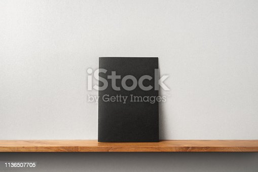istock front view of black magazine stand on bookshelf 1136507705