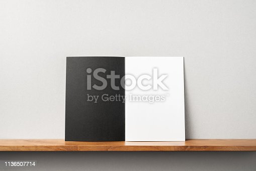 istock front view of black magazine stand on bookshelf 1136507714