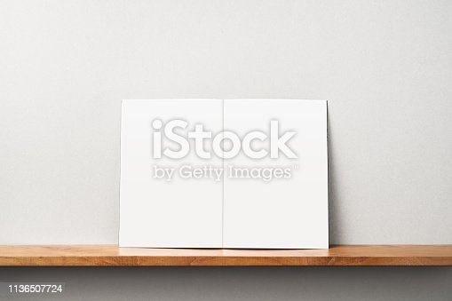 istock front view of black magazine stand on bookshelf 1136507724