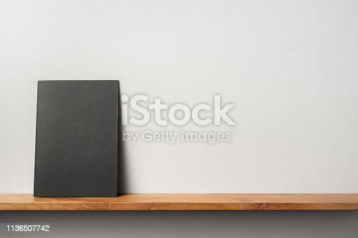 istock front view of black magazine stand on bookshelf 1136507742