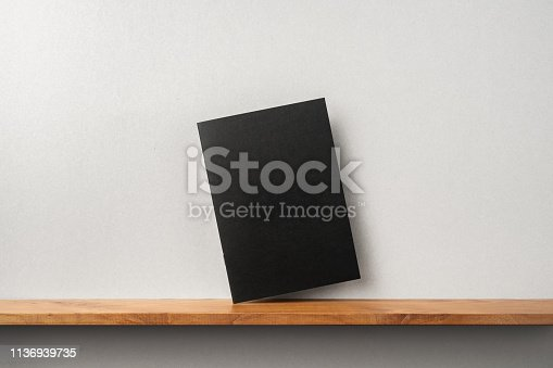 istock front view of black magazine stand on bookshelf 1136939735