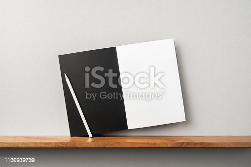 istock front view of black magazine stand on bookshelf 1136939739