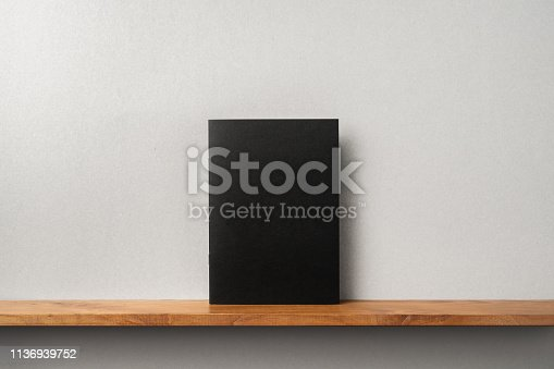 istock front view of black magazine stand on bookshelf 1136939752