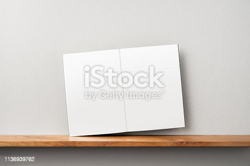 istock front view of black magazine stand on bookshelf 1136939762