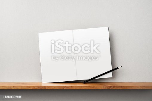 istock front view of black magazine stand on bookshelf 1136939768