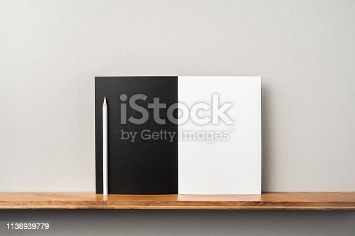istock front view of black magazine stand on bookshelf 1136939779