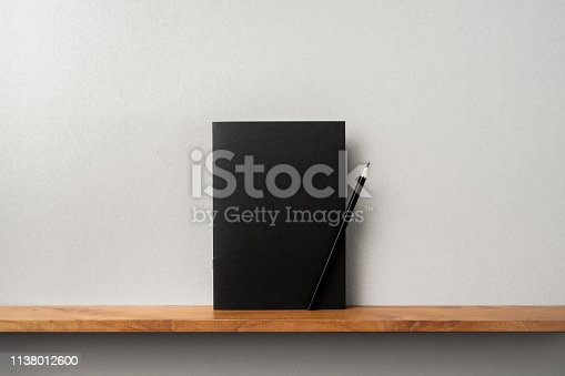 istock front view of black magazine stand on bookshelf 1138012600