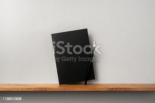 istock front view of black magazine stand on bookshelf 1138012608
