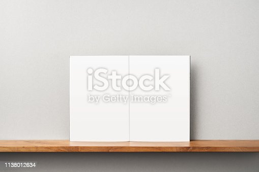 istock front view of black magazine stand on bookshelf 1138012634