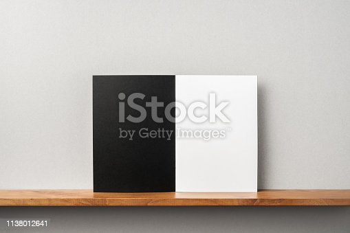 istock front view of black magazine stand on bookshelf 1138012641
