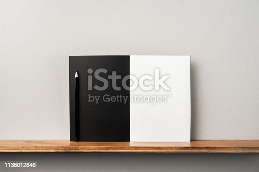 istock front view of black magazine stand on bookshelf 1138012646