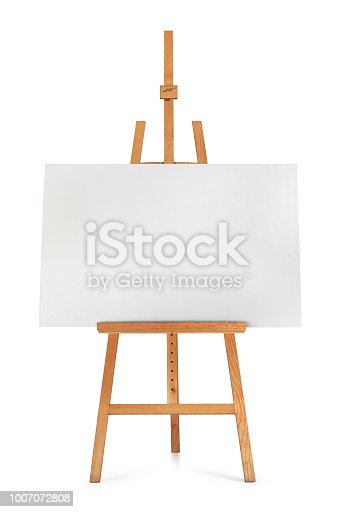 istock Front view of blank art board and wooden easel isolated on white background 1007072808