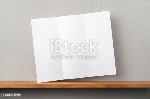 istock front view of blank brochure stand on bookshelf 1140031235