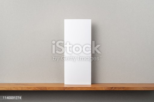 istock front view of blank brochure stand on bookshelf 1140031274