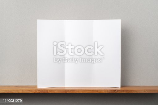 istock front view of blank brochure stand on bookshelf 1140031279