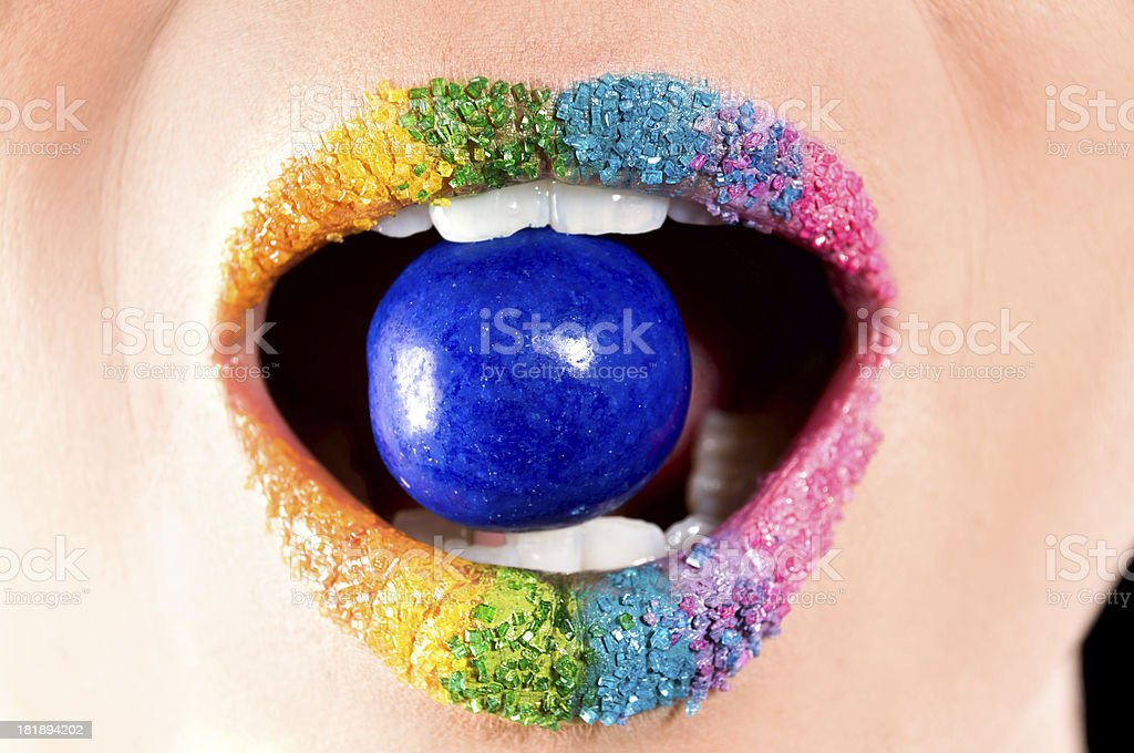 Front view of blue gumball in candy coated mouth. royalty-free stock photo
