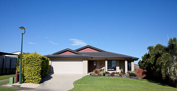 front view of bungalow style home - bungalow stock photos and pictures