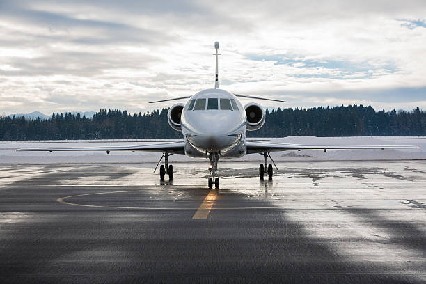 Front view of business jet on runway stock photo