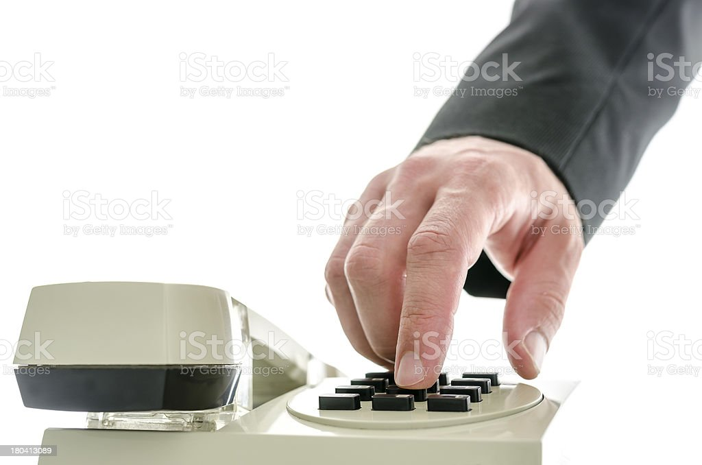 Front view of business man hand dialing a phone number royalty-free stock photo
