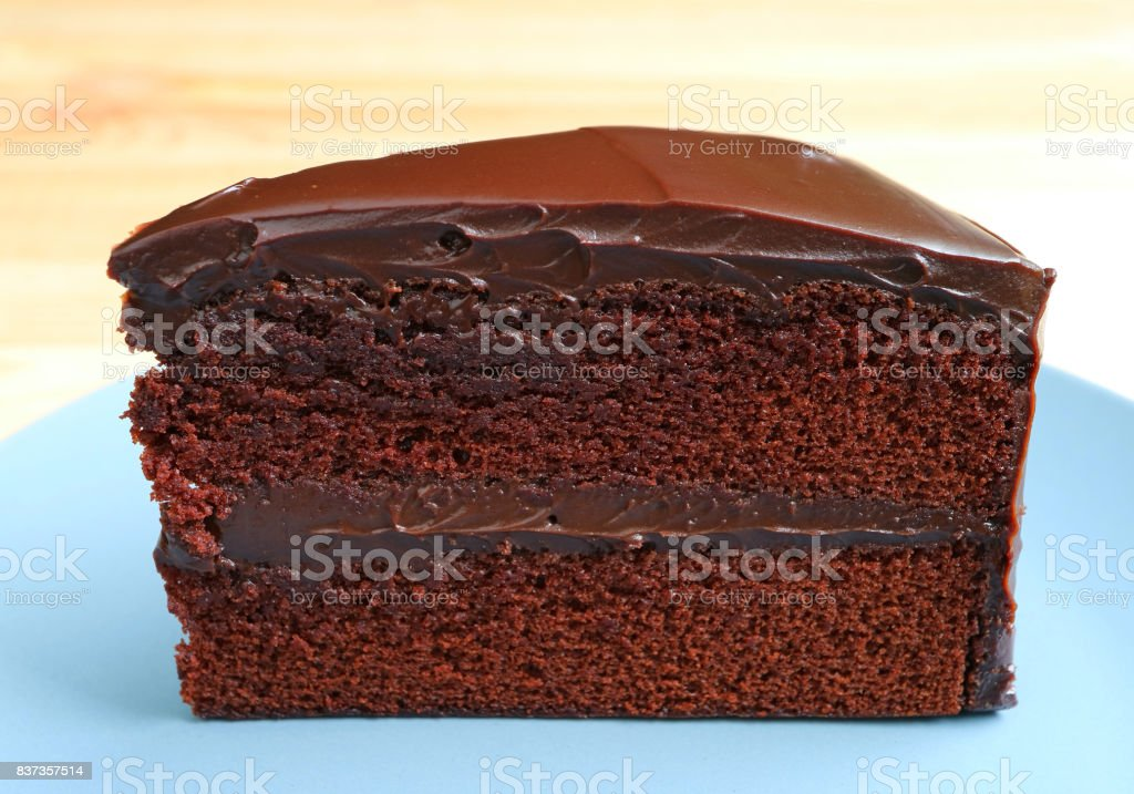 Front view of Chocolate Layer Cake Served on Wooden Table, Blurred Background - fotografia de stock