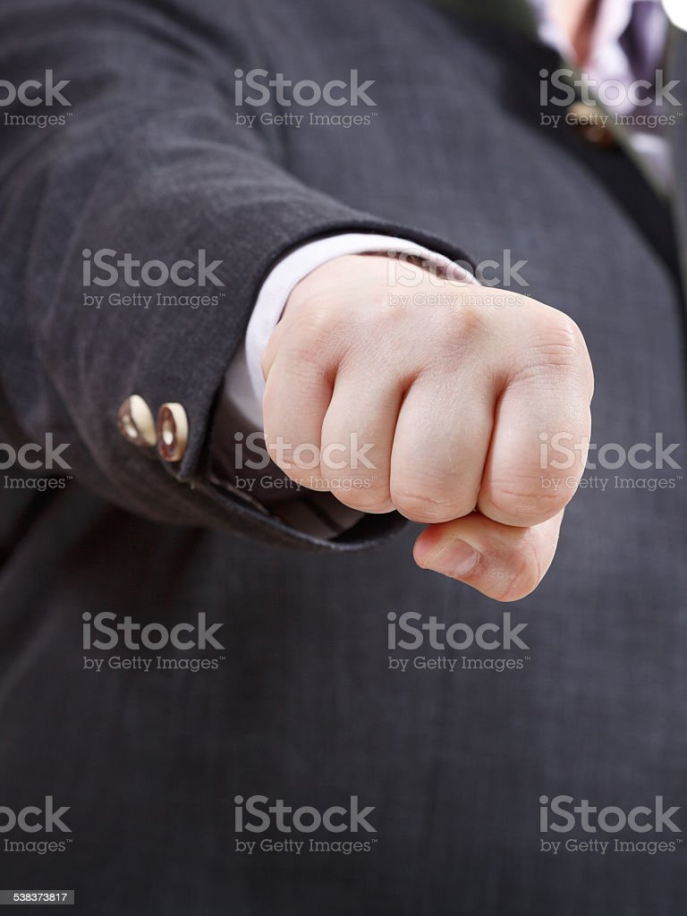 front view of clenched fist of businessman stock photo