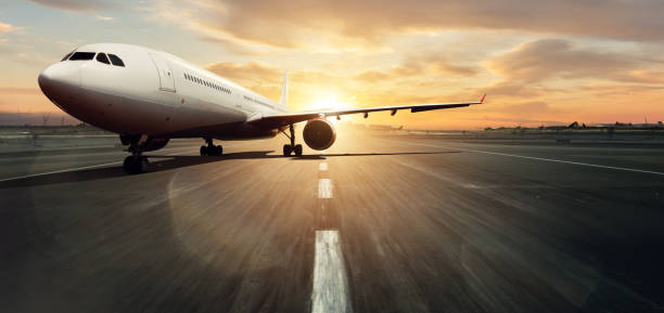 Front view of commercial airplane on runway stock photo