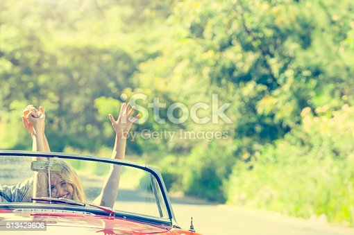 481388538 istock photo Front view of couple driving in a convertible car. 513429606