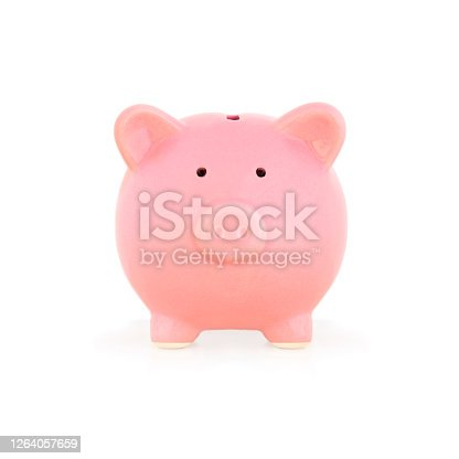 Front view of cute pink porcelain piggy bank close up against white background