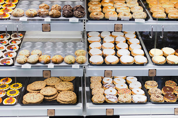 front view of donut selection in store - digital viewfinder stock photos and pictures