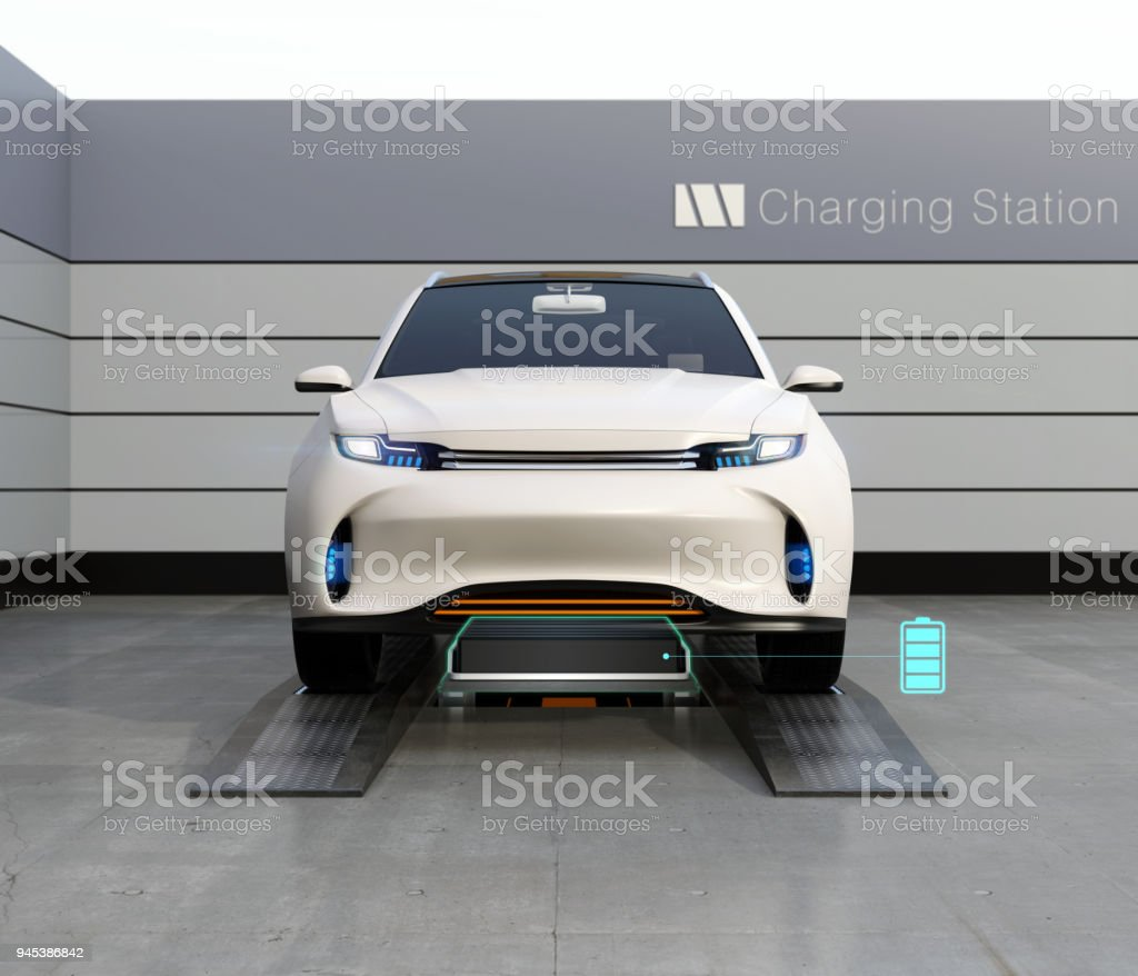 Front view of electric SUV car exchange low battery in battery swapping station stock photo