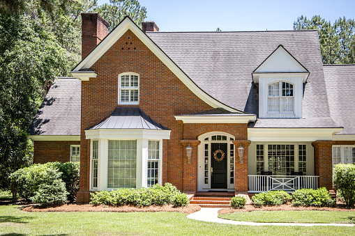 Front view of Exterior of Red Brick Traditional Southern Home
