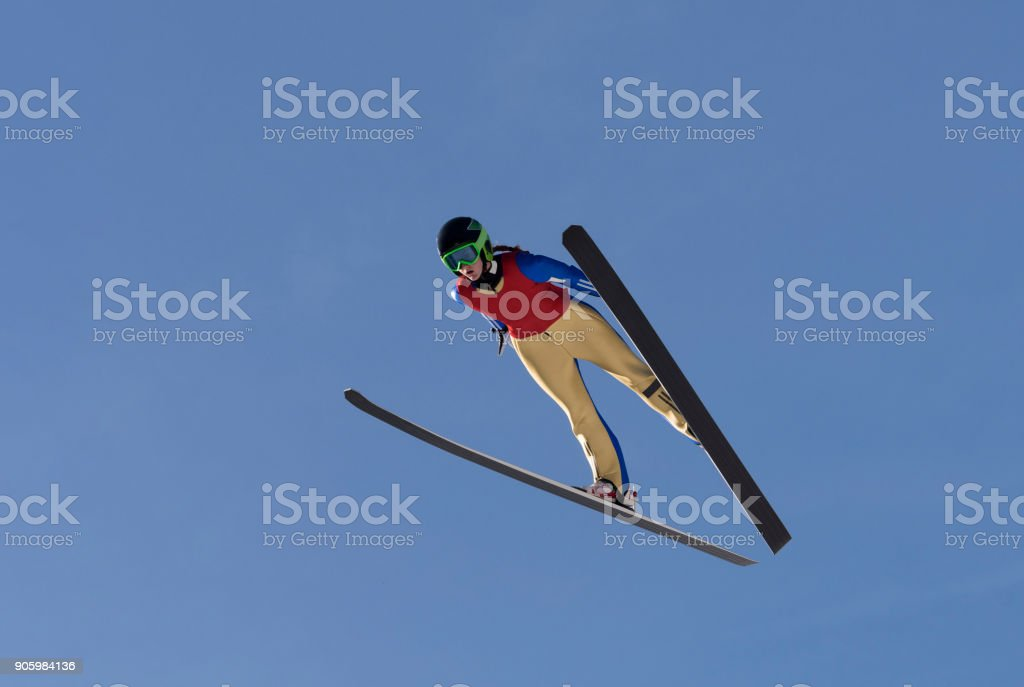 Front View of Female Ski Jumper in Mid-air stock photo